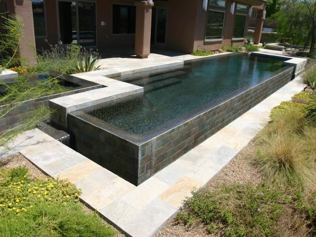 Mixed-Color Modern Pool With Deck and Spa