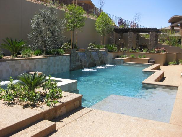 Pool and Patio With Waterfalls and Elevated Landscaping