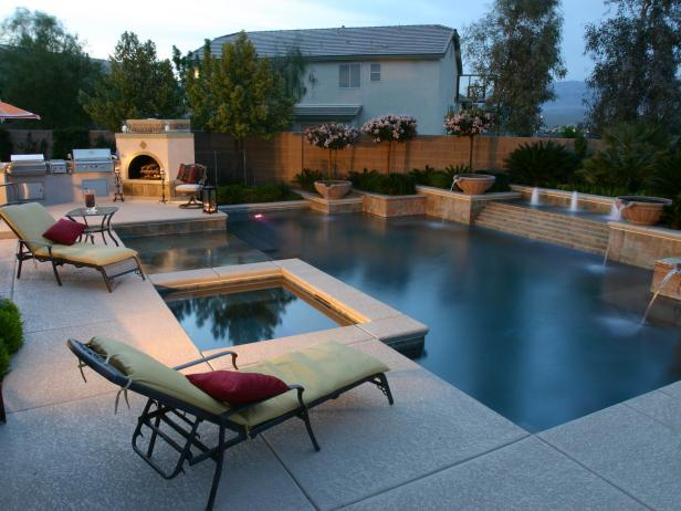 Backyard Tuscan Style Pool and Spa With Lounge Chairs