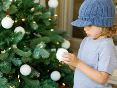 Boy Holding Handmade Snowball Ornament