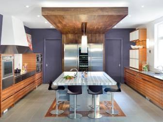 Modern Kitchen With Deep Purple Wall and Wood-Paneled Drop Ceiling