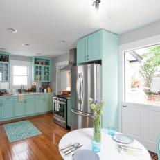 Bright Modern Kitchen with Teal Cabinets and Dutch Door