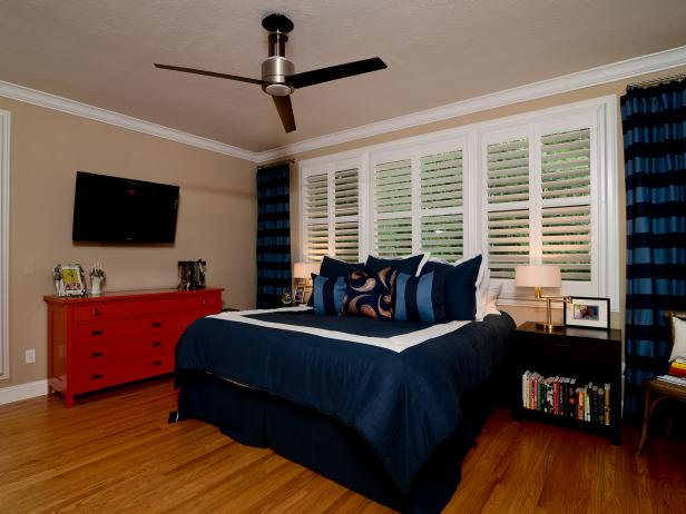 Transitional Bedroom With Blue Accents and Red Dresser