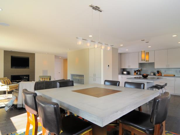 Contemporary Dining Room With Concrete Table and Leather Pub Chairs