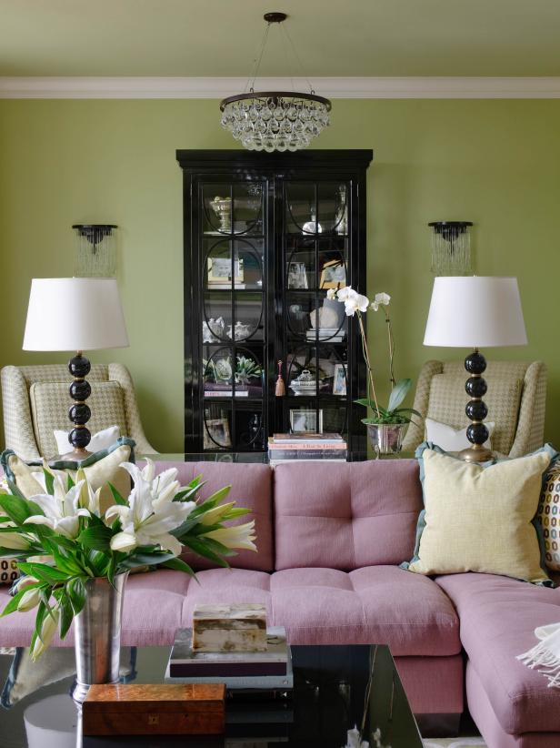 Green Transitional Living Room With Pink Couch and Yellow Chairs