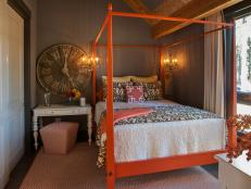 Guest Bedroom With Striking Orange Bed