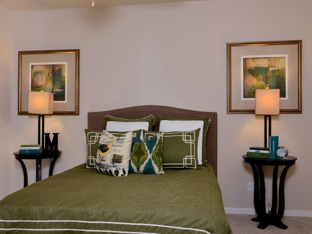 Bedroom with Upholstered Headboard and Green Linens