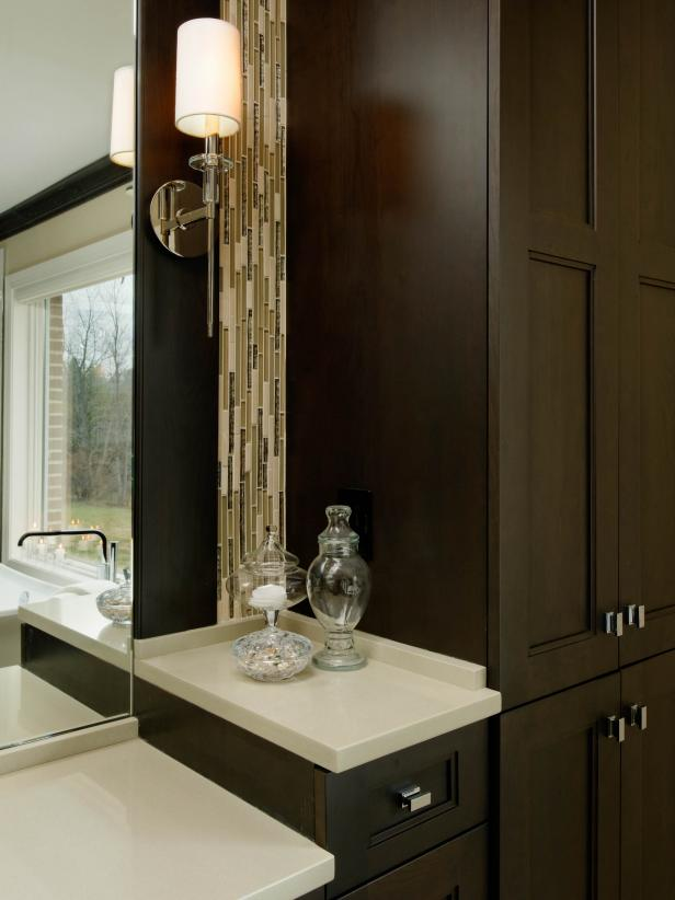 Brown Bathroom Cabinets With Vertical Glass Tile Backsplash