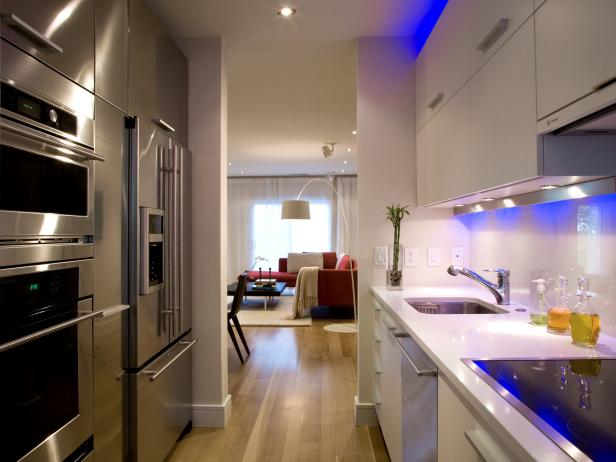 Galley Kitchen with White Cabinets, Blue Lighting and Stainless Steel Appliances