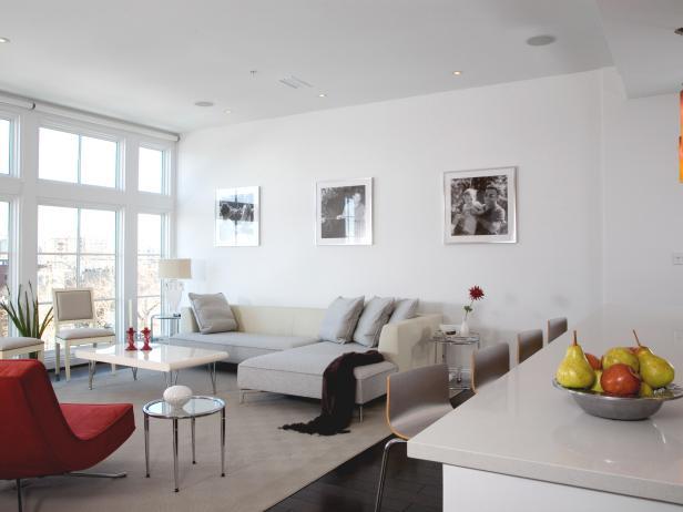 White Living Room with Gray Sectional and Red Chair