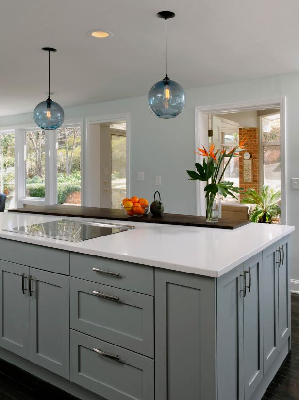 Family-Friendly Island With Blue Cabinetry and Globe Pendant Lighting