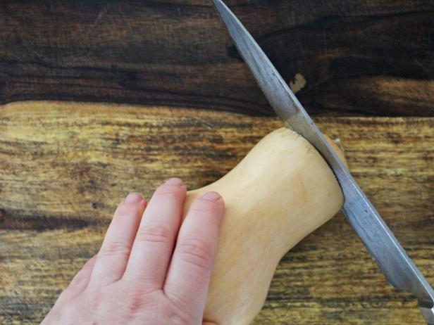 In step one of this project, use a sharp knife to cut the top off of the squash.