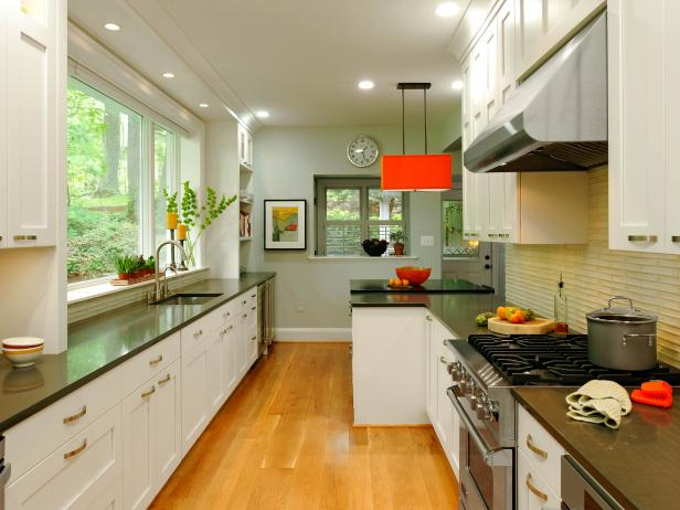 Contemporary Galley Kitchen with Orange Pendant and Hardwood Floors