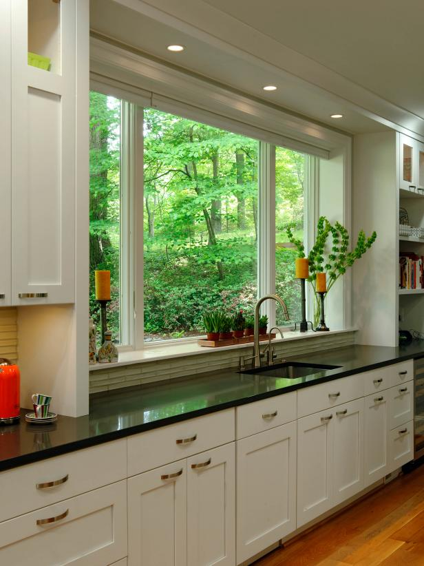 White Kitchen with Large Window and Black Quartz Countertop