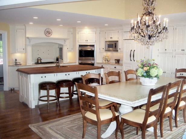 Traditional Kitchen With White Cabinets and Large Eat-In Island