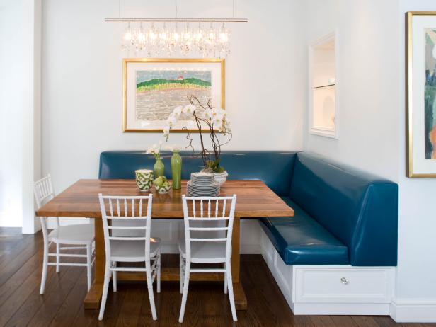 White Dining Area With Custom Wood Table and Blue Vinyl Banquette