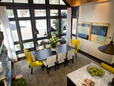 Dining Room With Full-Length Windows and Electric Yellow Chairs