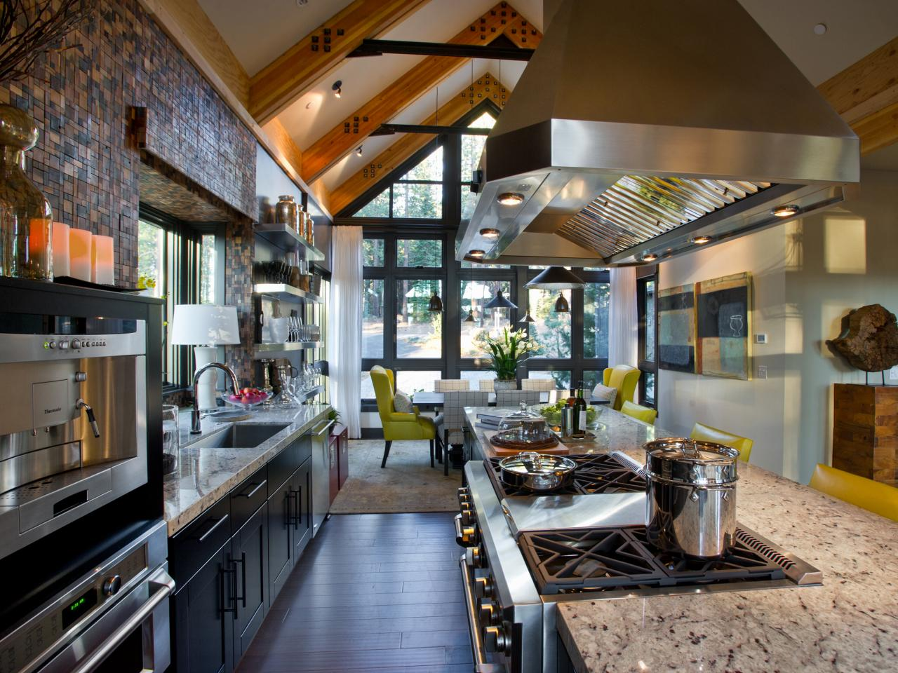 Galley Kitchen With Vaulted Ceiling And Stainless Range Hood The Kitchen Flows Straight Into The