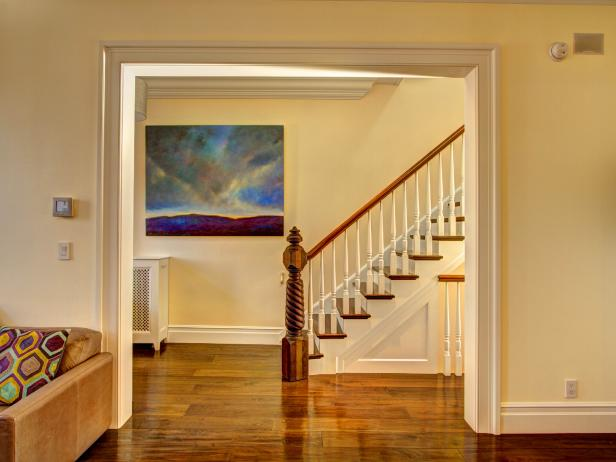 Beige Entryway With Carved Newel Post Staircase