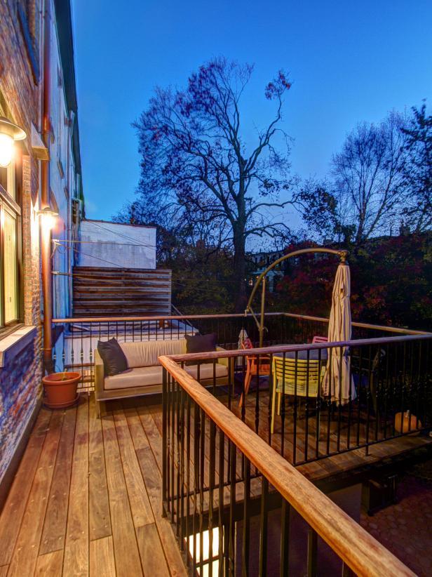 Ipe deck on urban brownstone surrounded by metal railing