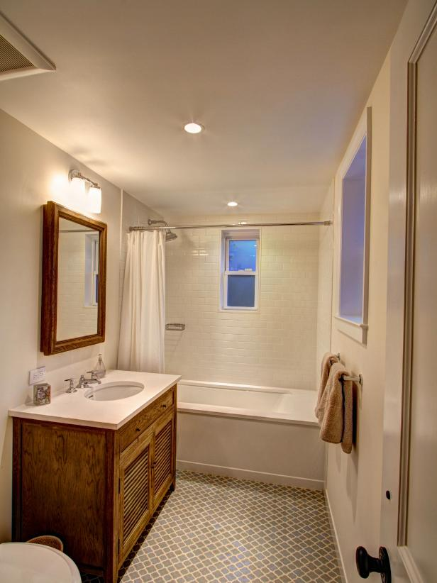 White Bathroom with Blue Moroccan Tile Floor and Rustic Vanity