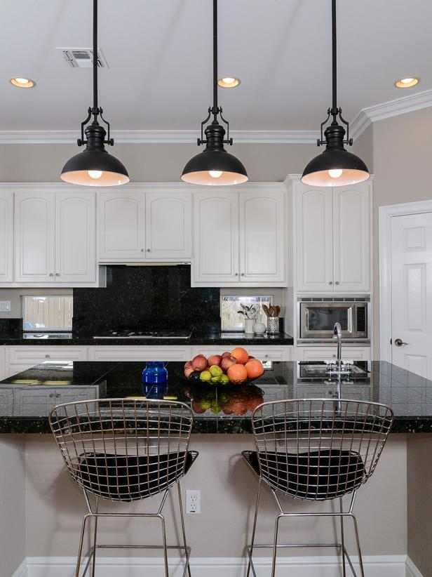 Black and White Kitchen with Black Pendants and Wire Barstools
