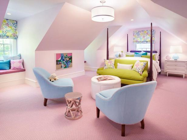 Light Pink Girl's Bedroom With Green Sofa, Blue Chairs and Window Seat