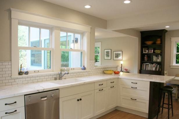 Open Plan Kitchen With White Countertops and White Cabinets