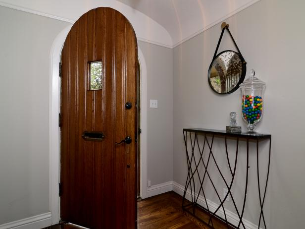 Neutral Foyer with Arched Front Door and Narrow Console