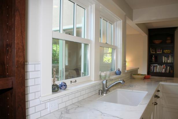 White Kitchen With Undermount Sink and Subway Tile Backsplash