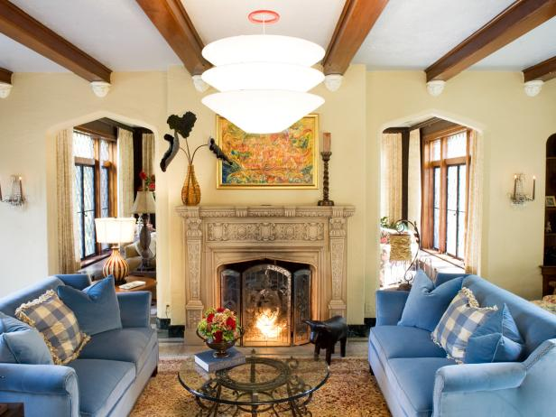 Living Room with Blue Sofas, Ornate Mantel and Exposed Beams