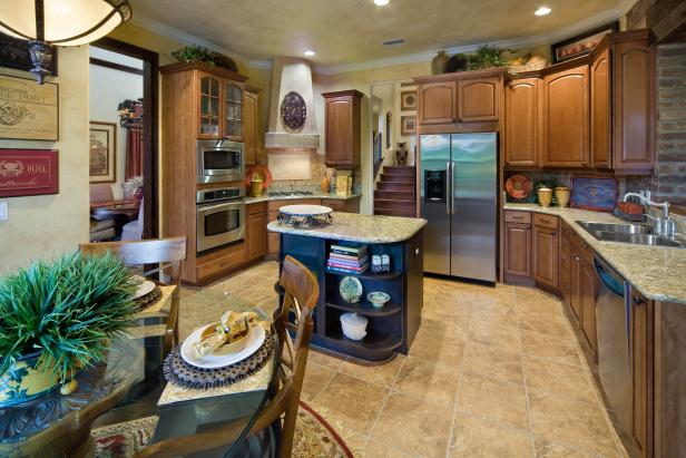 Mediterranean Kitchen With Wood Cabinets and Center Island