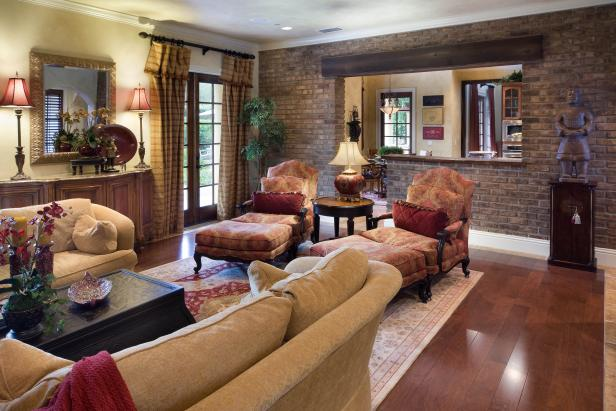Mediterranean Family Room With Chaise Longue Chairs and Brick Wall
