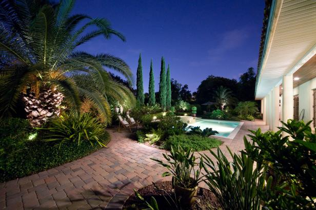Tropical Pool With Terra-Cotta-Paved Entrance and Landscaping