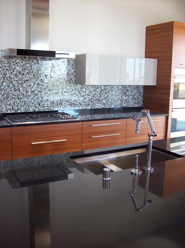 Contemporary Kitchen With Black Granite Countertops