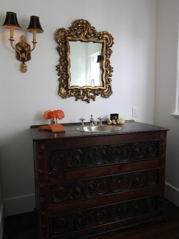 White Mediterranean Bathroom With Antique Vanity