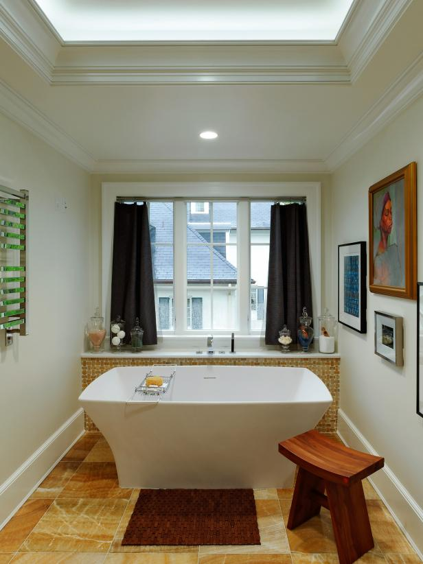 White Bathroom With Soaking Tub and Onyx Tile Flooring