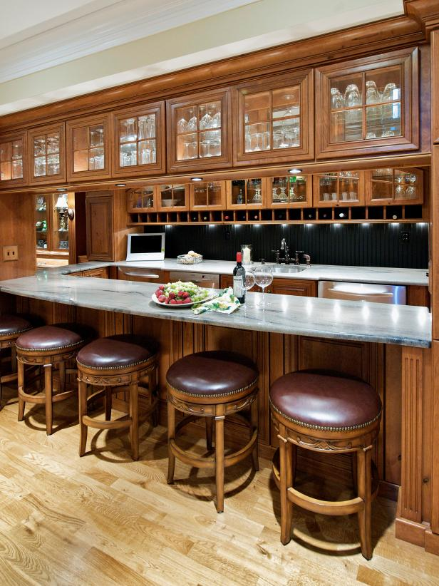 Traditional Bar With Glass-Front Cabinets and Custom Barstools