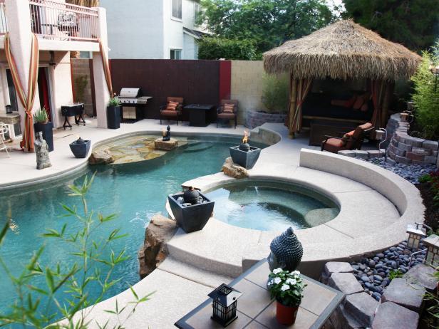 Pool With Tiki-Style Cabana and Raised Spa