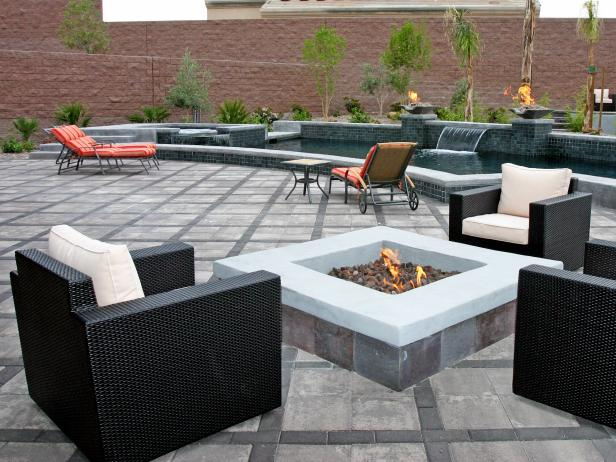 Modern Patio With Stone Firepit and Tiled Water Feature