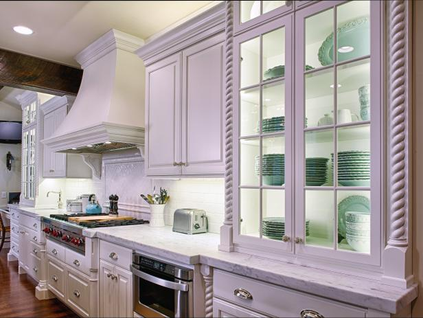 White Cottage Kitchen With Glass-Front Cabinet and Mint Dinnerware