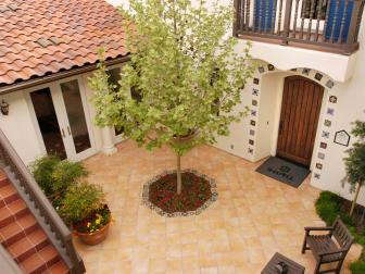 Southwestern Tile Courtyard Patio With Barrel Tile Roof