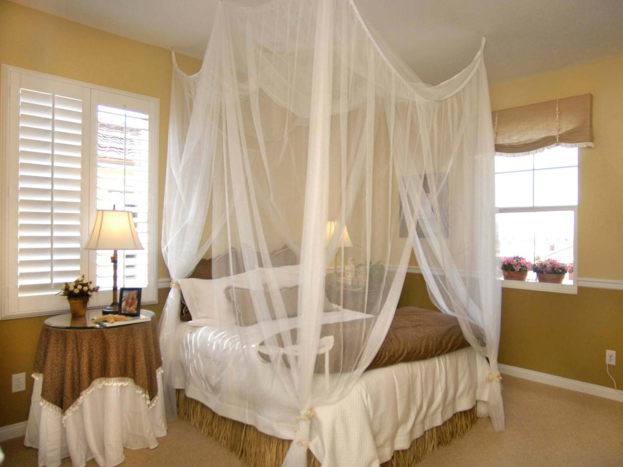 Romantic bedroom with billowing canopy bed hgtv - How to decorate a canopy bed ...