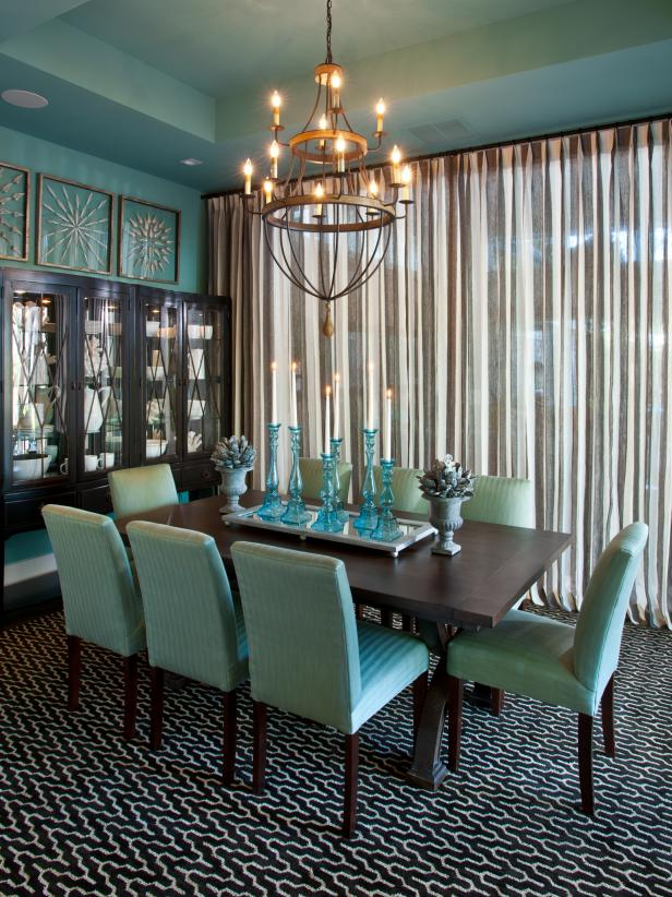Dining room with transitional furnishings in brown and blue.