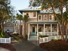 Coastal Home With Porch and White Fence