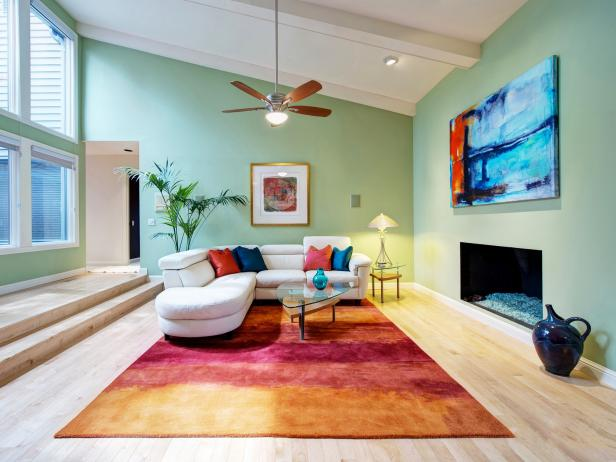 Green Contemporary Living Room With Bold Rug and Ceiling Fan