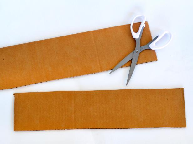 Cut one flap in half. Save one half and discard the other.