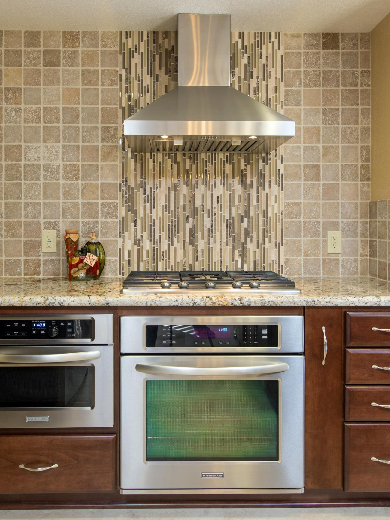 Glass And Natural Stone Tile Kitchen Backsplash This Kitchen S Designer Chose To Install Glass