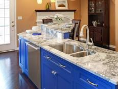 Kitchen With Marble Countertops and Bright Blue Island