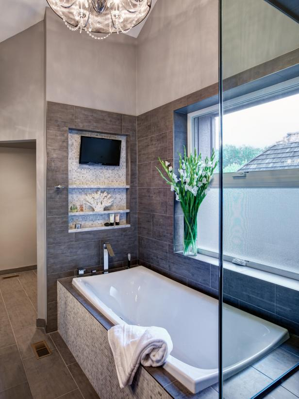 Neutral Bathroom with Soaking Tub, TV & Frosted Window